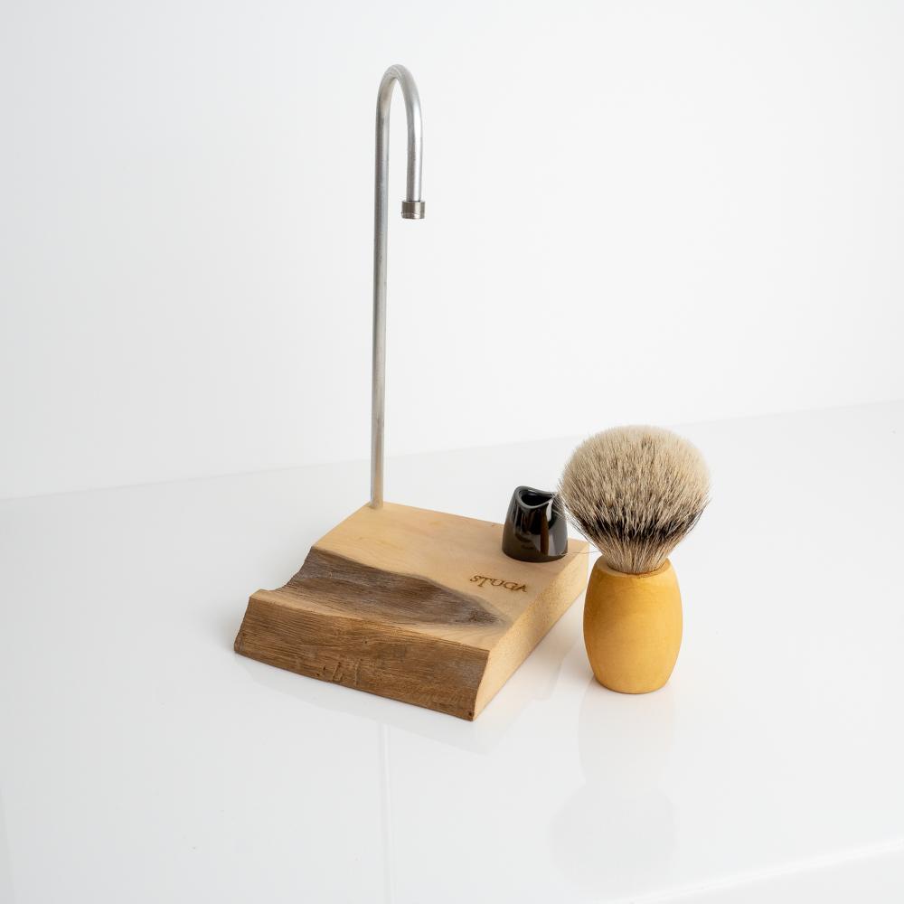 magic shaving brush next to stand