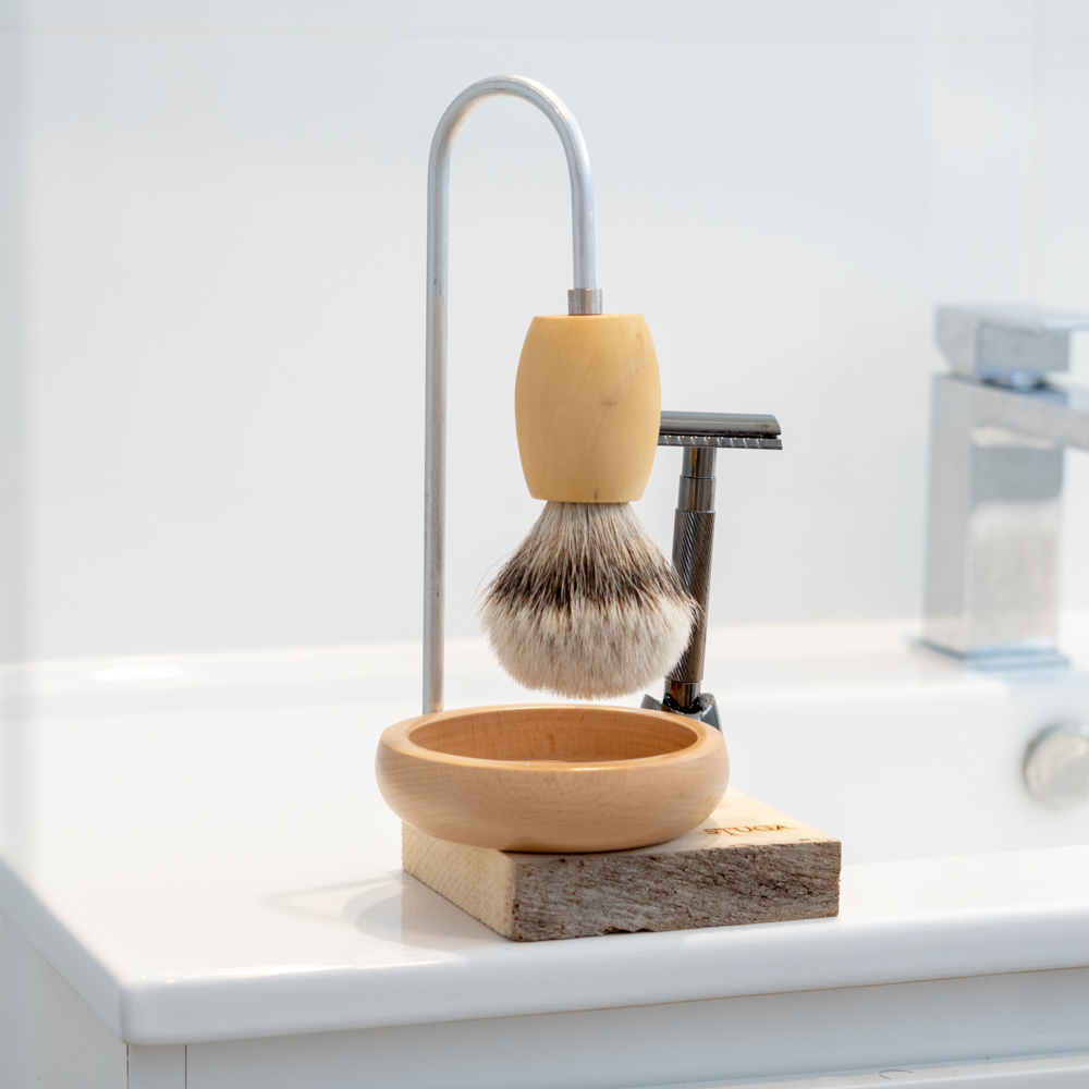 Stuga magic shaving kit in bathroom with de edge safety razor, brush and bowl on stand