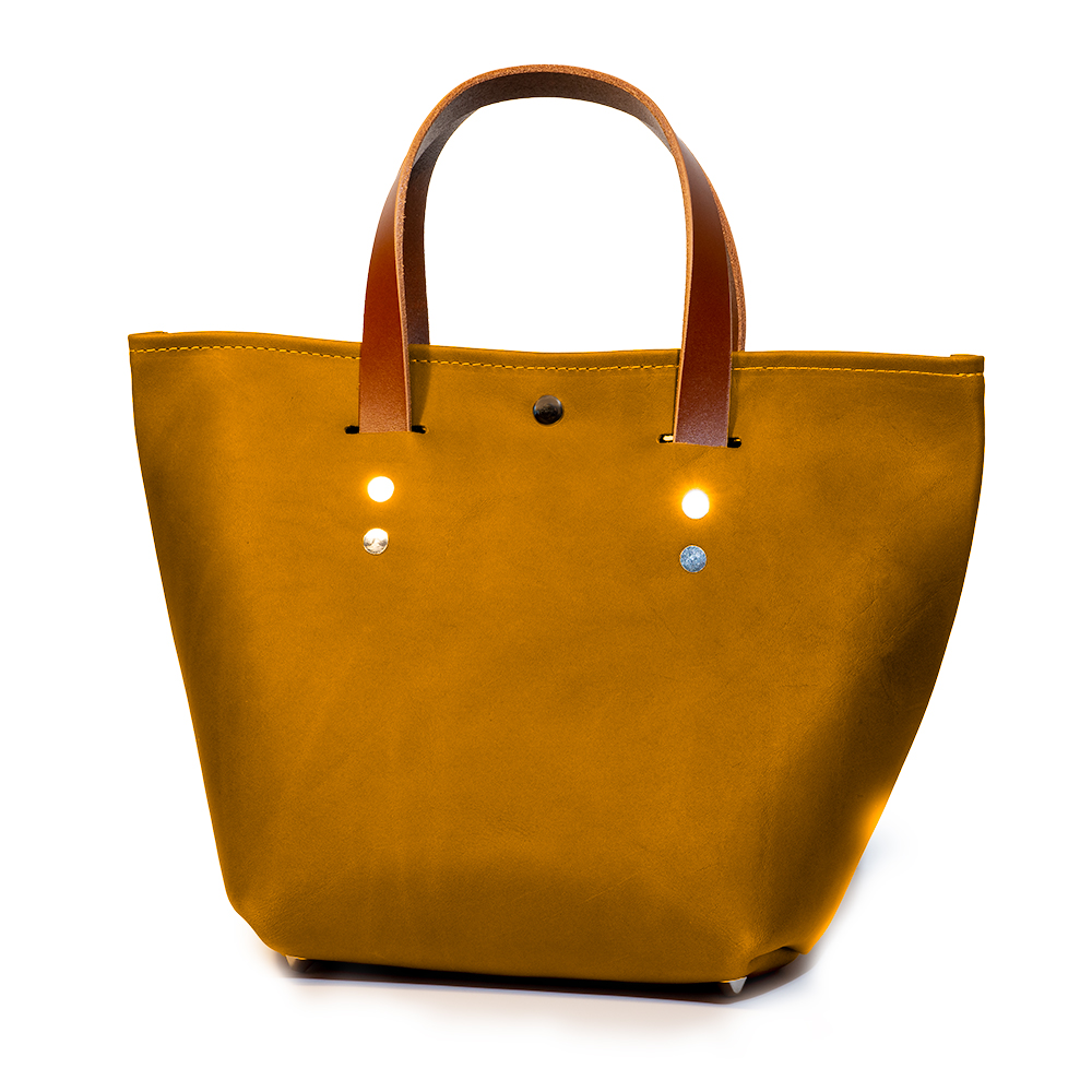 front angle closed of small mini tote made with amber australia cow leather