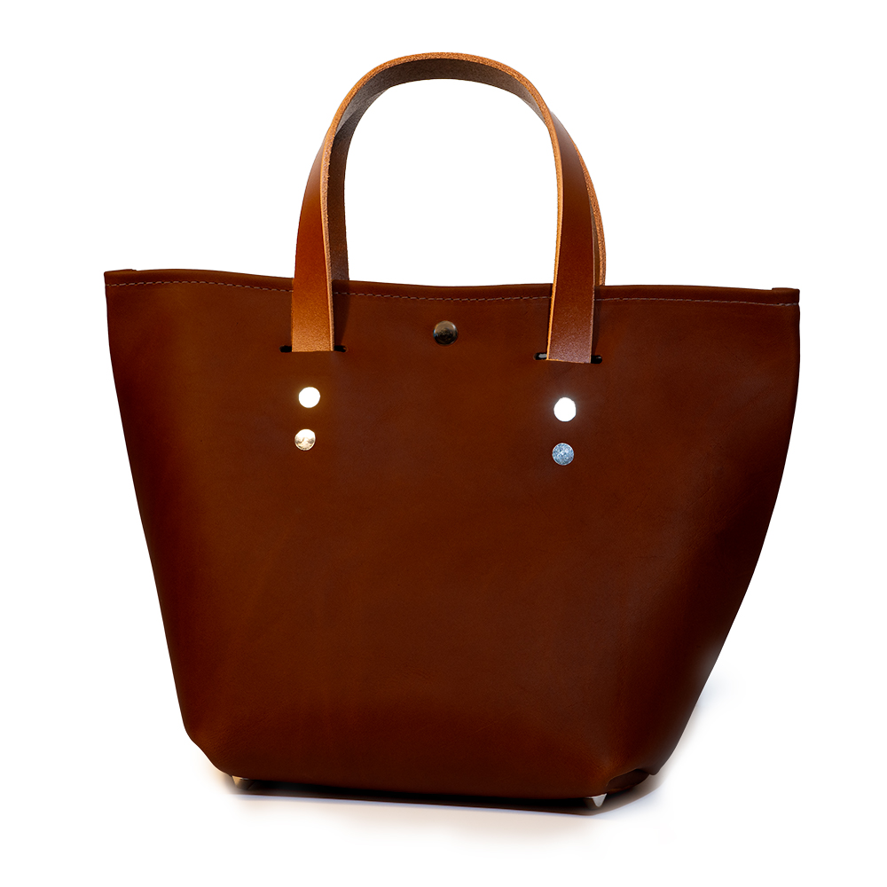 front angle closed of small mini tote made with red australia cow leather