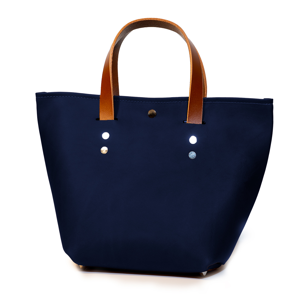 front angle closed of small mini tote made with navy australia cow leather