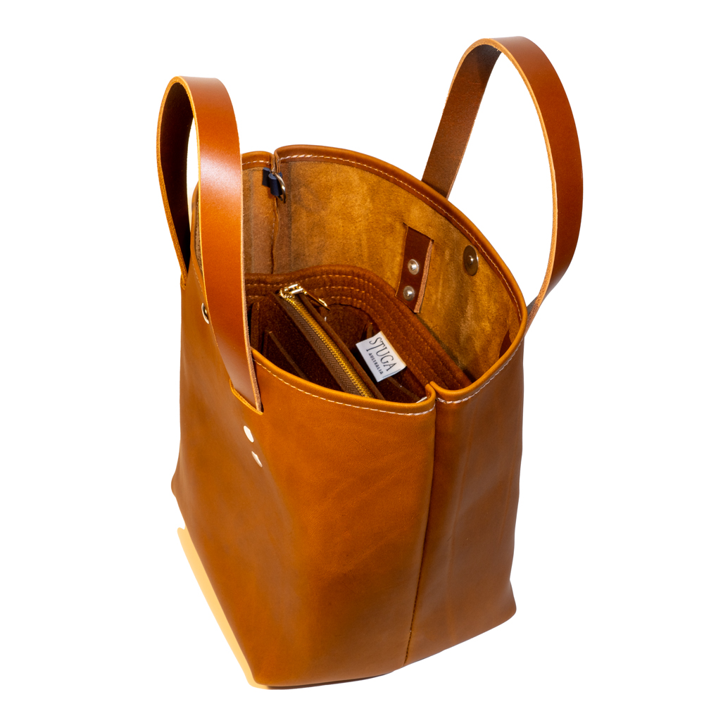 side angle of large tote made with tan australia cow leather