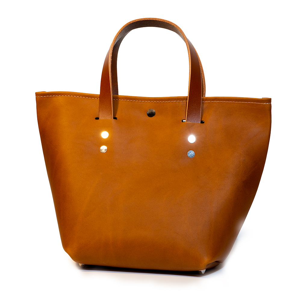 front angle closed of small mini tote made with tan australia cow leather