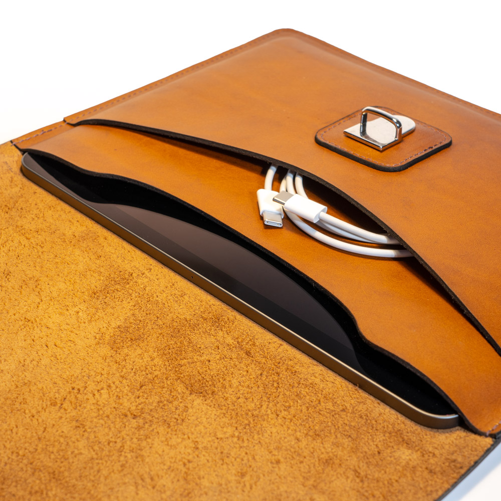australian leather ipad case tuck lock in chrome and showing an ipad and cable inside